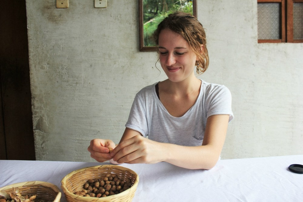 Peanut-butter-workshop-with-De-La-Gente-Antigua-Guatemala-Charlie-on-Travel-Charlie-shelling-the-peanuts